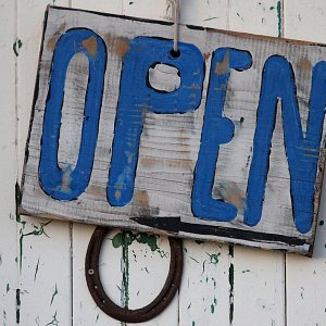 A wooden open sign